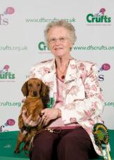 Click to enlarge Ellen with Ch Sonderbar Billie Jean at Stargang winning Best of Breed Crufts 2011